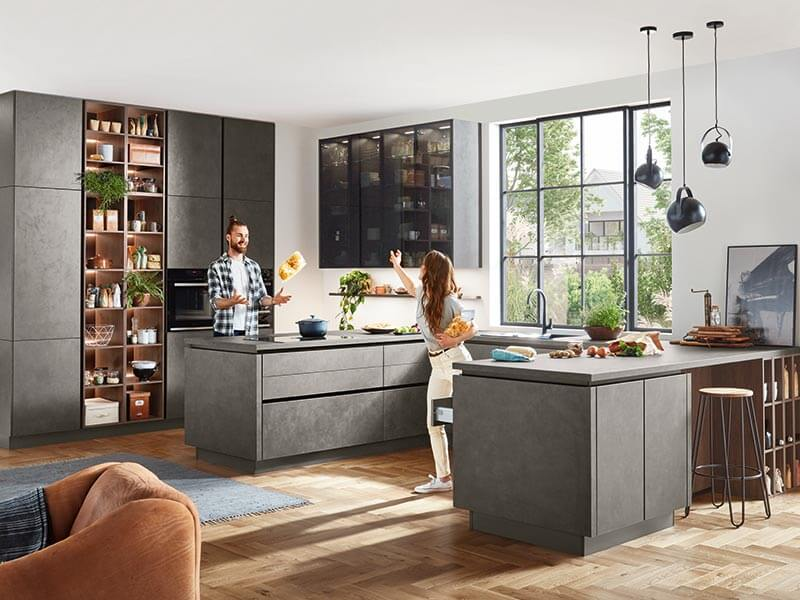 U-Küche grau Beton-Optik modern mit zwei Backöfen mit Theke